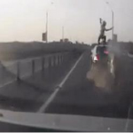 A Belarusian biker's  reflexes help him dodge death after rear-ending a BMW at 85kph