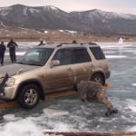 Russians Get Car Out Of A Frozen Lake By Hand (Must Watch Video)
