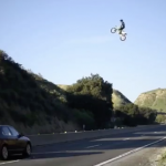 Stunt Jump By Motorcycle Over Highway In California